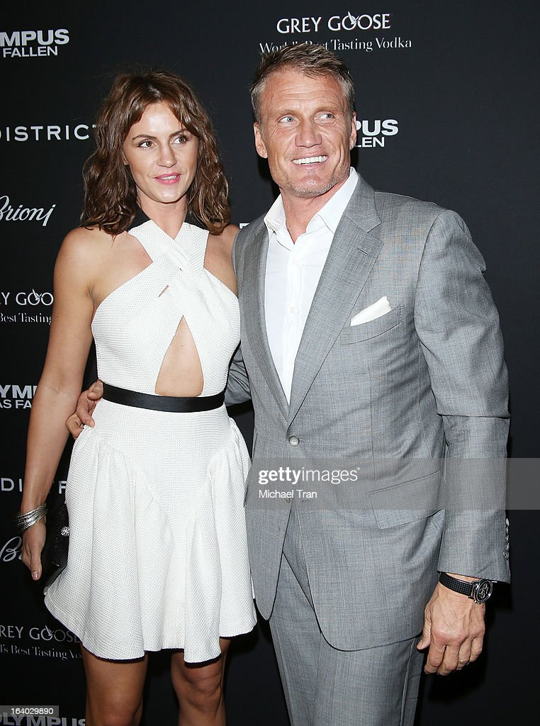 <a gi-track='captionPersonalityLinkClicked' href=/galleries/search?phrase=Dolph+Lundgren&family=editorial&specificpeople=216371 ng-click='$event.stopPropagation()'>Dolph Lundgren</a> (R) and guest arrive at the Los Angeles premiere of 'Olympus Has Fallen' held at ArcLight Cinemas Cinerama Dome on March 18, 2013 in Hollywood, California.