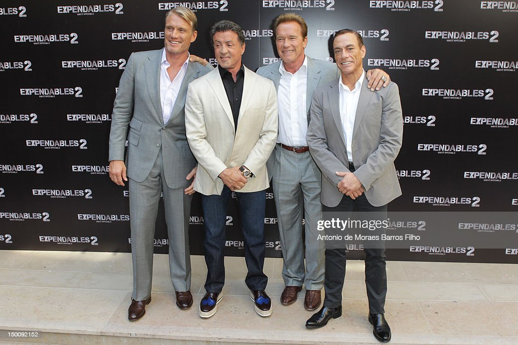 <a gi-track='captionPersonalityLinkClicked' href=/galleries/search?phrase=Dolph+Lundgren&family=editorial&specificpeople=216371 ng-click='$event.stopPropagation()'>Dolph Lundgren</a>, <a gi-track='captionPersonalityLinkClicked' href=/galleries/search?phrase=Sylvester+Stallone&family=editorial&specificpeople=202604 ng-click='$event.stopPropagation()'>Sylvester Stallone</a>, <a gi-track='captionPersonalityLinkClicked' href=/galleries/search?phrase=Arnold+Schwarzenegger&family=editorial&specificpeople=156406 ng-click='$event.stopPropagation()'>Arnold Schwarzenegger</a> and <a gi-track='captionPersonalityLinkClicked' href=/galleries/search?phrase=Jean-Claude+Van+Damme&family=editorial&specificpeople=566465 ng-click='$event.stopPropagation()'>Jean-Claude Van Damme</a> attend 'The Expendables 2' Photocall at Hotel George V on August 10, 2012 in Paris, France.