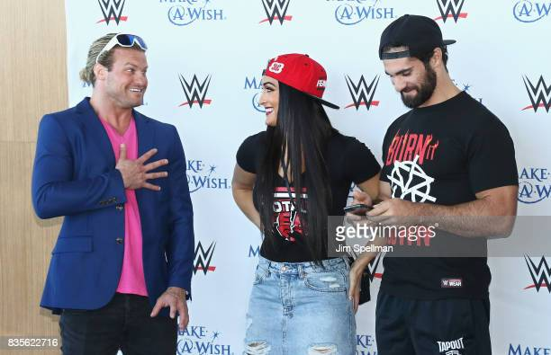 Dolph Ziggler Nikki Bella and Seth Rollins attend the WWE Superstars Surprise MakeAWish Families at One World Observatory on August 19 2017 in New...