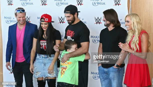 Dolph Ziggler Nikki Bella Seth Rollins AJ Styles and Dana Warrior surprise a wish kid at the WWE Superstars Surprise MakeAWish Families at One World...