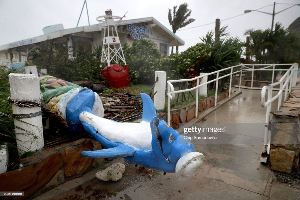 A dolphin statue at the Anglins Fishing Pier lies toppled by Hurricane Irma September 10, 2017 in Fort Lauderdale, Florida. The Category 4 hurricane made landfall in the United States in the Florida Keys at 9:10 a.m. after raking across the north coast of Cuba.