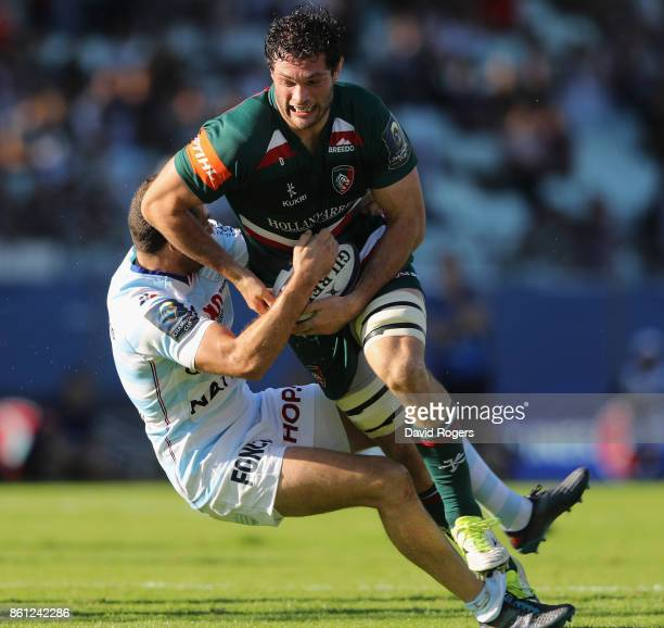 Dom Barrow of Leicester is tackled by Henry Chavancy during the European Rugby Champions Cup match between Racing 92 and Leicester Tigers at Stade...