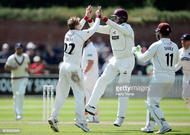 Dom Bess of Somerset and Marcus Trescothick of Somerset celebrates after dismissing Mark Stoneman of Surrey during Day Four of the Specsavers County...
