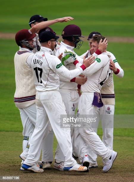 Dom Bess of Somerset celebrates the wicket of Adam Voges of Middlesex during Day Two of the Specsavers County Championship Division One match between...