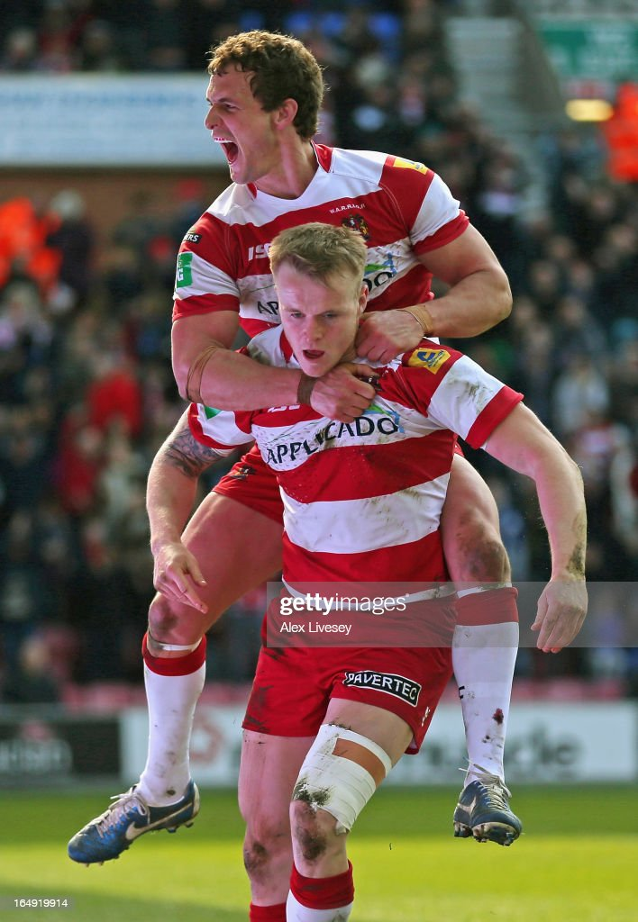 Dom Crosby of Wigan Warriors celebrates with Sean O'Loughlin after scoing his try during the Super League match between Wigan Warriors and St Helens at DW Stadium on March 29, 2013 in Wigan, England.
