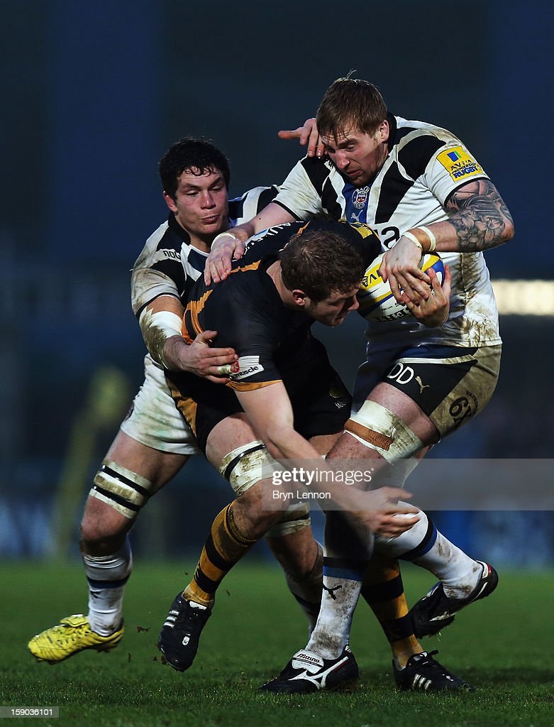 Dom Day of Bath Rugby is tackled by Joe Launchbury of London Wasps during the Aviva Premiership match between London Wasps and Bath at Adams Park on January 6, 2013 in High Wycombe, England.