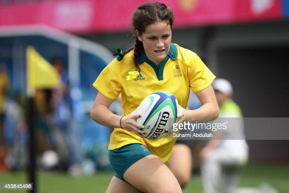 Dom du Toit of Australia runs with the ball and scores a try at the Rugby Sevens Final on day four of the Nanjing 2014 Summer Youth Olympic Games at...