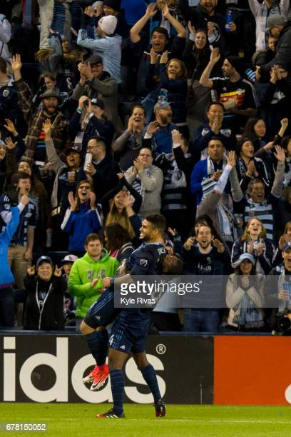 Dom Dwyer is lifted into the air by Jimmy Medranda of Sporting Kansas City in celebration after scoring the second goal of the game in the second...