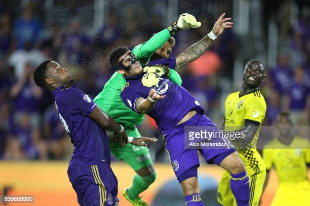 Dom Dwyer of Orlando City SC collides with goalkeeper Zack Steffen of Columbus Crew SC during a MLS soccer match between the Columbus Crew SC and the...