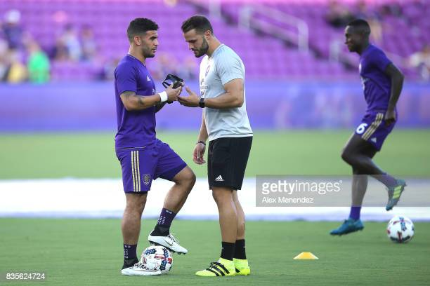 Dom Dwyer of Orlando City SC speaks to a coach about his protective mask prior to the start of a MLS soccer match between the Columbus Crew SC and...