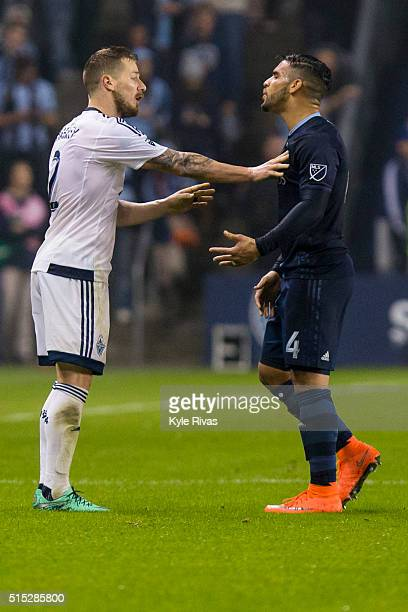 Dom Dwyer of Sporting Kansas City argues with Jordan Harvey of Vancouver Whitecaps in the second half on March 12 2016 at Children's Mercy Park in...