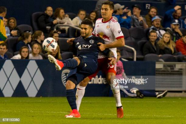 Dom Dwyer of Sporting Kansas City fights off Aaron Long of New York Red Bulls in the second half at Children's Mercy Park on May 03 2017 in Kansas...