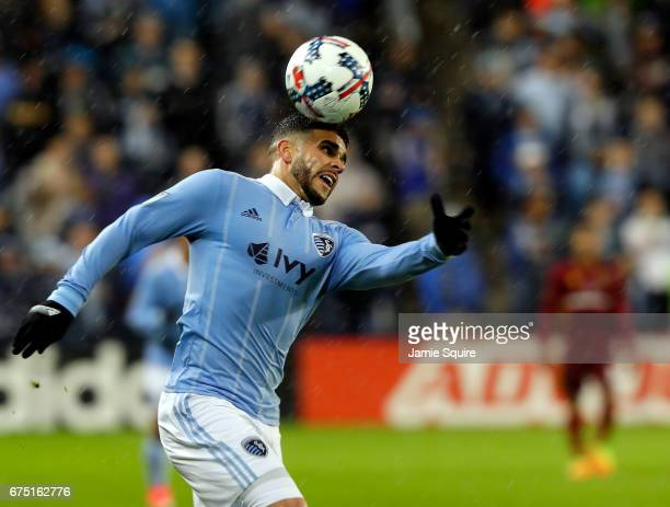 Dom Dwyer of Sporting Kansas City heads the ball during the game against Real Salt Lake at Children's Mercy Park on April 29 2017 in Kansas City...