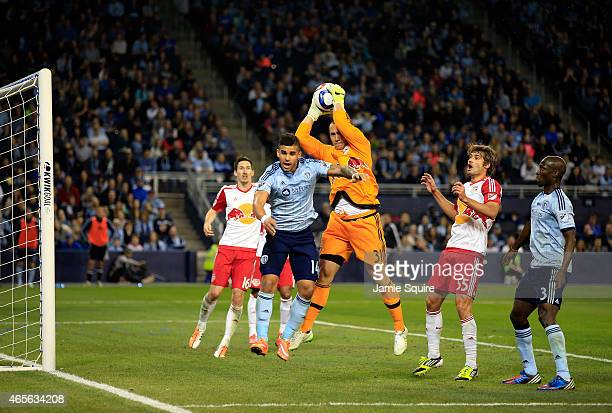 Dom Dwyer of Sporting KC tries to score as Luis Robles of New York Red Bulls makes a save during the game at Sporting Park on March 8 2015 in Kansas...