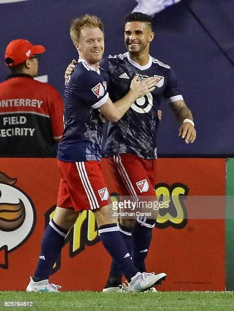 Dom Dwyer of the MLS AllStars is congratulated by teammate Dax McCarty after scoring a goal against Real Madrid during the 2017 MLS All Star Game at...