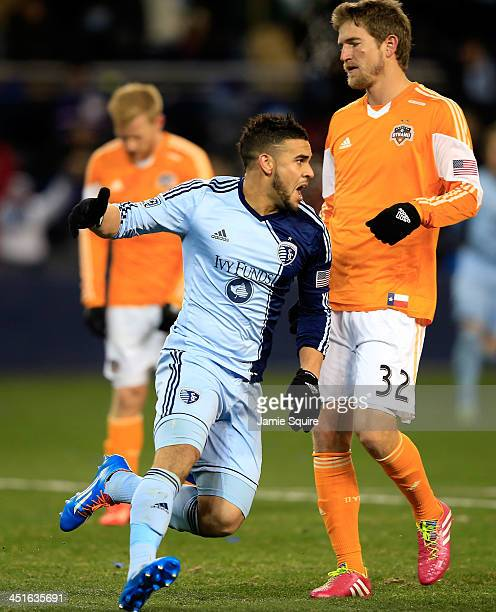 Dom Dwyer of the Sporting KC celebrates after scoring the gamewinning goal as Bobby Boswell of the Houston Dynamo looks down during Leg 2 of the...