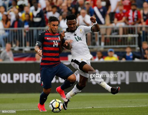 Dom Dwyer of the United States battles defender Jerry Akaminko of Ghana in the first half during an international friendly between USA and Ghana at...
