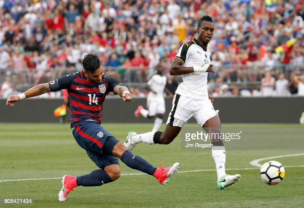 Dom Dwyer of the United States shoots by defender John Boye of Ghana in the first half during an international friendly between USA and Ghana at...