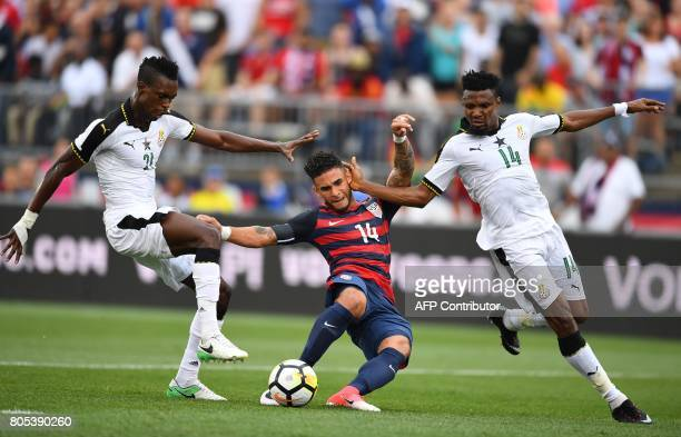 Dom Dwyer of the US Men's National Team drives past Ghana John Boye and Jerry Akaminko during their International Friendly match July 1 2017 at Pratt...