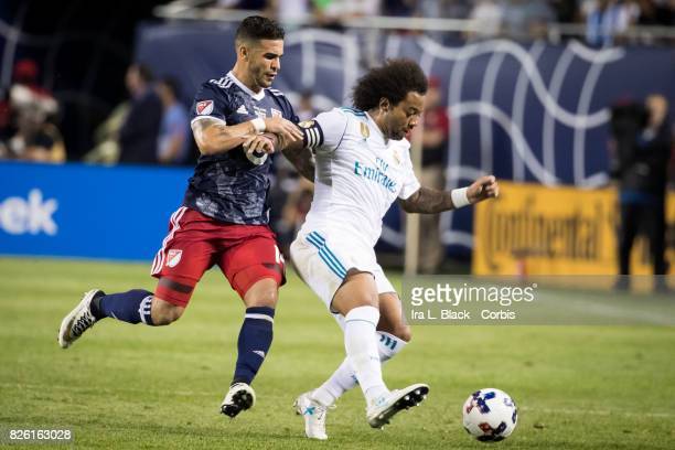 Dom Dwyer of United States puts the pressure on Marcelo of Real Madrid during the MLS AllStar match between the MLS AllStars and Real Madrid at the...