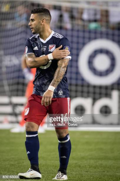 Dom Dwyer of United States taps his shoulder as a tip of the hat to his team Orlando City SC during the MLS AllStar match between the MLS AllStars...