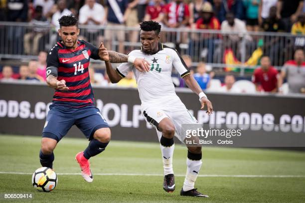 Dom Dwyer of US Mens National Team fights for control against Jerry Akaminko of the Ghana National Team during the International Friendly Match...