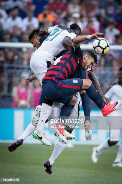 Dom Dwyer of US Men's National Team goes up for the ball against John Boye of the Ghana National Team during the International Friendly Match between...