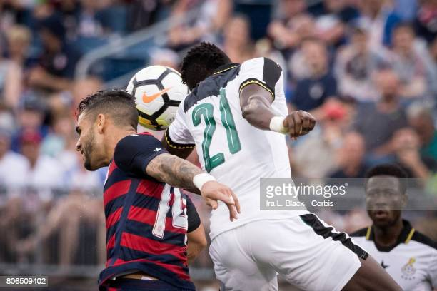 Dom Dwyer of US Men's National Team goes up for the header against John Boye of the Ghana National Team during the Gold Cup Match between US Men's...
