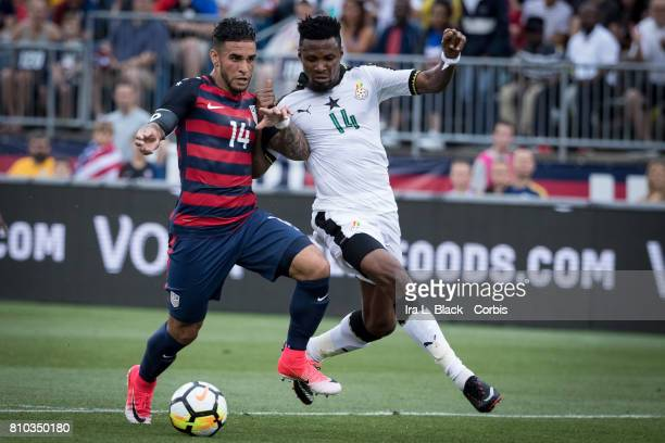 Dom Dwyer of US Men's National Team locks shoulders with Jerry Akaminko of the Ghana National Team during the International Friendly Match between US...