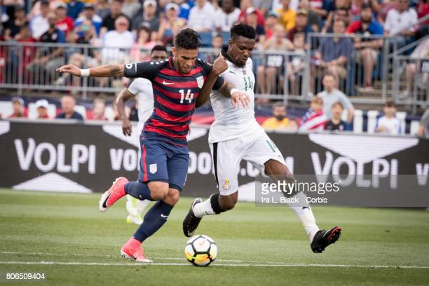 Dom Dwyer of US Mens National Team tries to outrun Jerry Akaminko of the Ghana National Team during the International Friendly Match between US Mens...