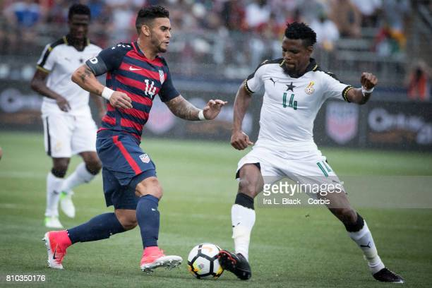 Dom Dwyer of US Men's National Team tries to outrun Jerry Akaminko of the Ghana National Team during the International Friendly Match between US...