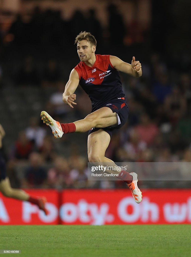 Dom Dyson of the Demons kicks the ball during the round six AFL match between the Melbourne Demons and the St Kilda Saints at Etihad Stadium on April 30, 2016 in Melbourne, Australia.