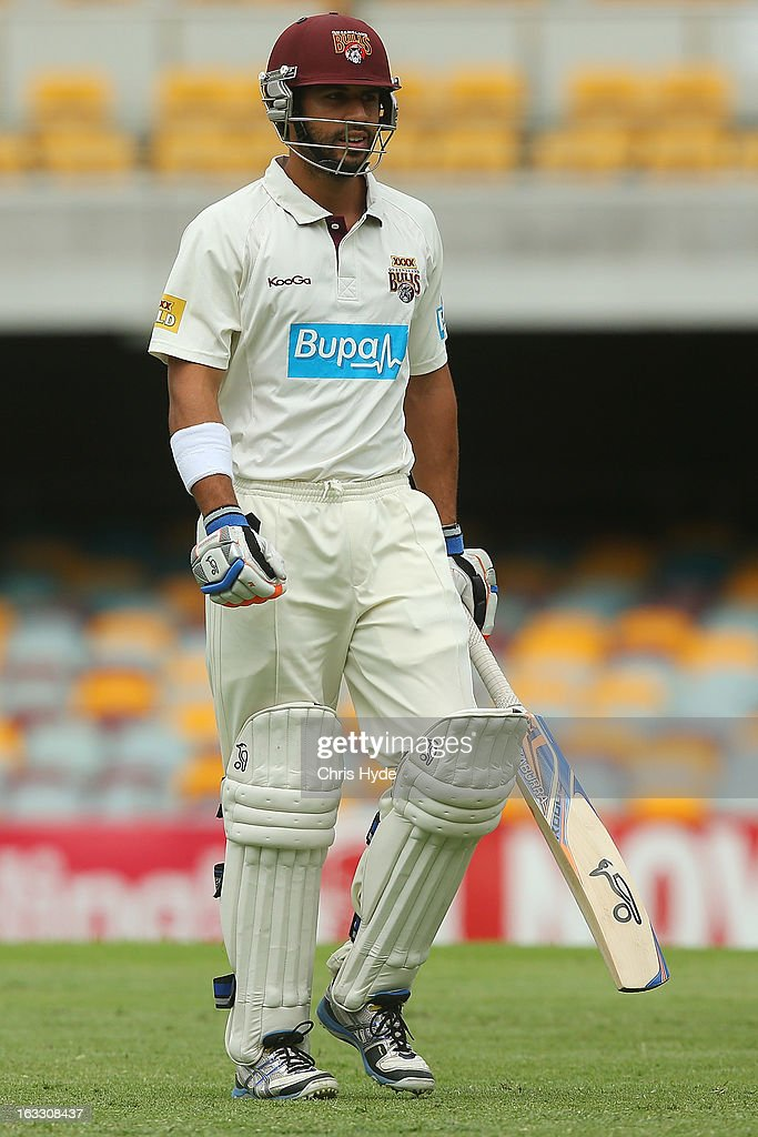 Dom Michael of the Bulls leaves the crease after being dismissed for a duck by Ben Hilfenhaus of the Tigers during day two of the Sheffield Shield match between the Queensland Bulls and the Tasmanian Tigers at The Gabba on March 8, 2013 in Brisbane, Australia.
