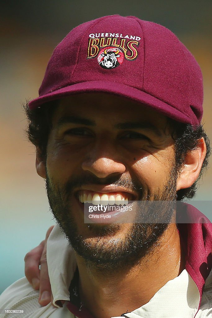 Dom Michael of the Bulls smiles during day one of the Sheffield Shield match between the Queensland Bulls and the Tasmanian Tigers at The Gabba on March 7, 2013 in Brisbane, Australia.