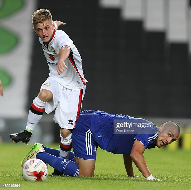 Dom Palmiero of MK Dons looks to move past the challenge of Oriol Romeu of Chelsea during the PreSeason Friendly match between MK Dons and Chelsea XI...