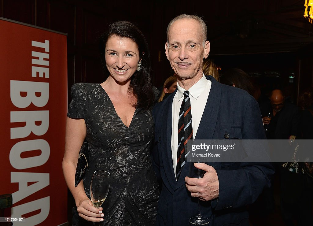 Dom Perignon's Julia Fitzroy (L) and director John Waters attend the Dom Perignon Reception after The Un-Private Collection: Jeff Koons and John Waters in Conversation at Orpheum Theatre on February 24, 2014 in Los Angeles, California.