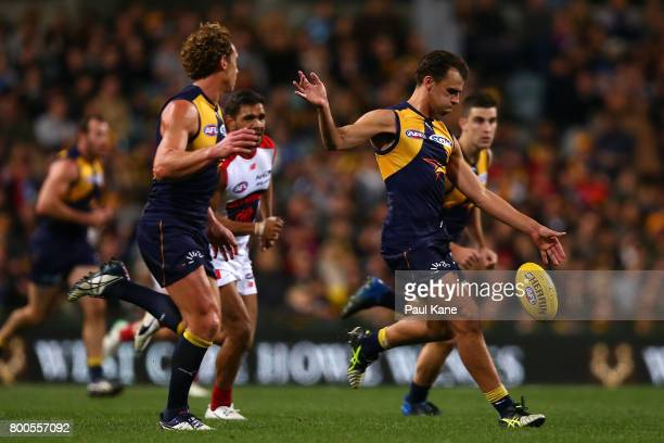 Dom Sheed of the Eagles kicks the ball during the round 14 AFL match between the West Coast Eagles and the Melbourne Demons at Domain Stadium on June...