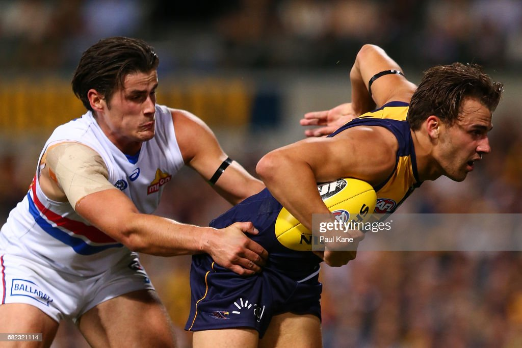 Dom Sheed of the Eagles looks to break from a tackle by Tom Boyd of the Bulldogs during the round eight AFL match between the West Coast Eagles and the Western Bulldogs at Domain Stadium on May 12, 2017 in Perth, Australia.