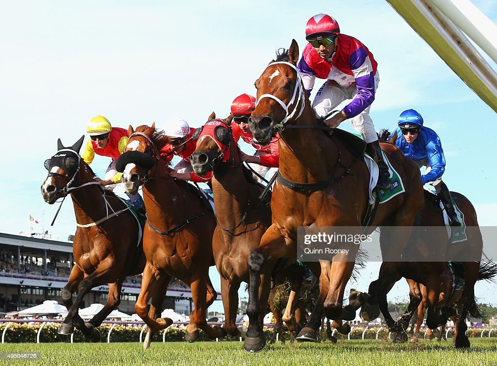 Dom Torneur rides Eclair Choice to win race 9 The tabcomau Stakes on Derby Day at Flemington Racecourse on October 31 2015 in Melbourne Australia