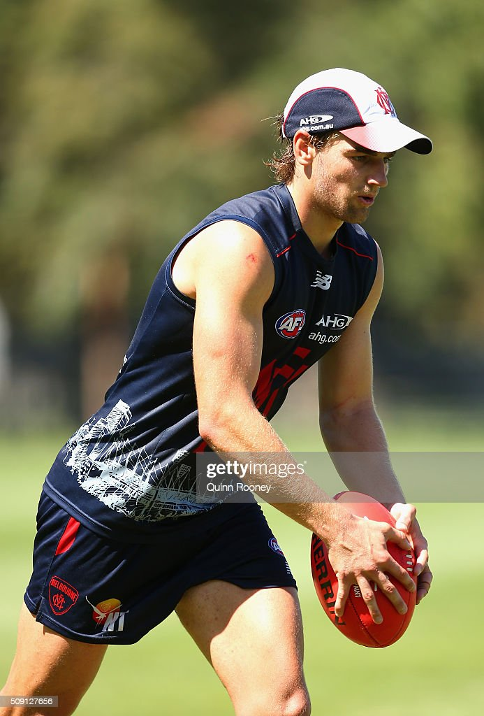 Dom Tyson of the Demons kicks during a Melbourne Demons AFL pre-season training session at Gosch's Paddock on February 9, 2016 in Melbourne, Australia.