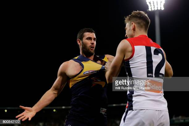 Dom Tyson of the Demons remonstrates with Jack Darling of the Eagles during the round 14 AFL match between the West Coast Eagles and the Melbourne...