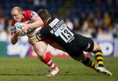 Dom Waldouck of London Wasps tackles running with the ball Mike Tindall of Gloucester during the Amlin Challenge Cup Quarter Final match between...