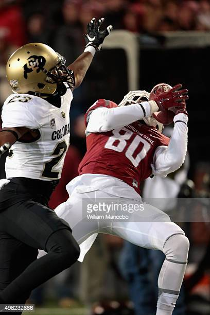 Dom Williams of the Washington State Cougars catches a pass against Ahkello Witherspoon of the Colorado Buffaloes in the first half at Martin Stadium...