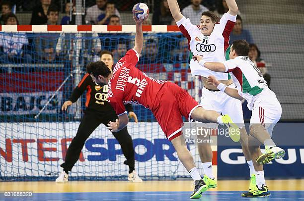 Domagoj Dunjak of Croatia takes a shot towards the goal during the 25th IHF Men's World Championship 2017 match between Hungary and Croatia at...