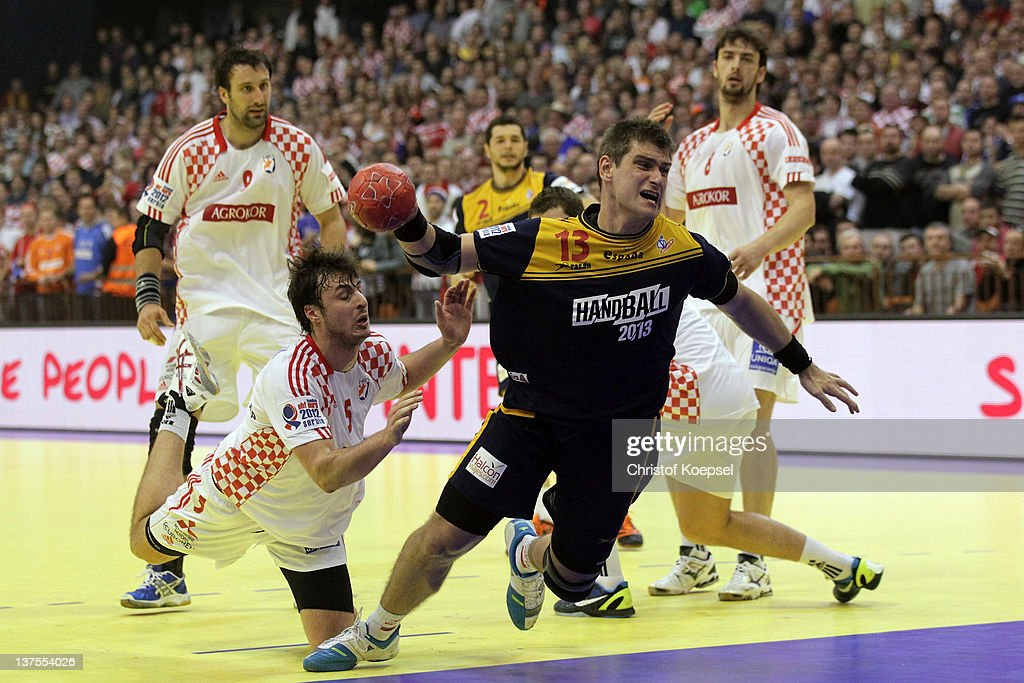Domagoj Duvnjak of Croatia #ö defends against Julen Aguinagalde of Spain (R) during the Men's European Handball Championship second round group two match between Spain and Croatia at Spens Arena on January 22, 2012 in Novi Sad, Serbia.