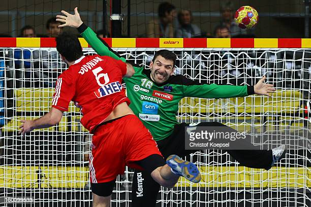 Domagoj Duvnjak of Croatia scores a goal Primoz Prost of Slovenia during the Men's Handball World Championship 2013 third place match between...