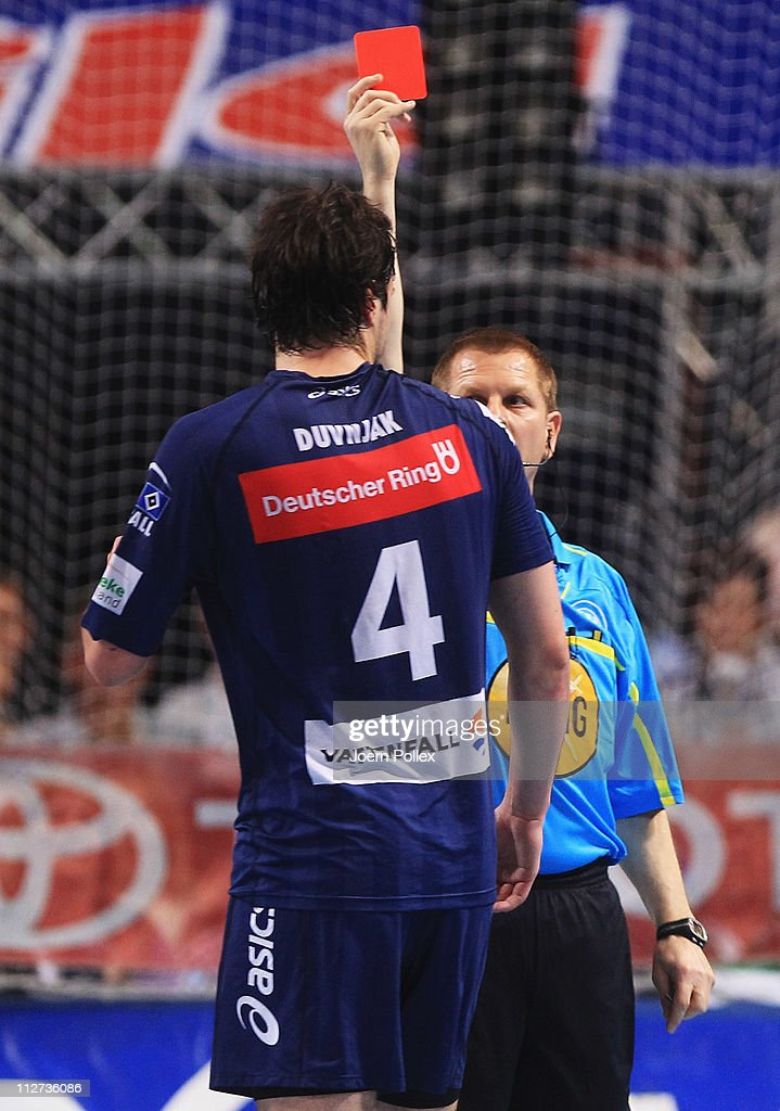 Domagoj Duvnjak (L) of Hamburg gets the red card during the Toyota Handball Bundesliga match between THW Kiel and HSV Hamburg at the Sparkassen Arena on April 20, 2011 in Kiel, Germany.