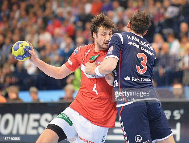 Domagoj Duvnjak of Hamburg is challenged by Tobias Karlsson of Flensburg during the Velux EHF Champions League quarter final second leg match between...
