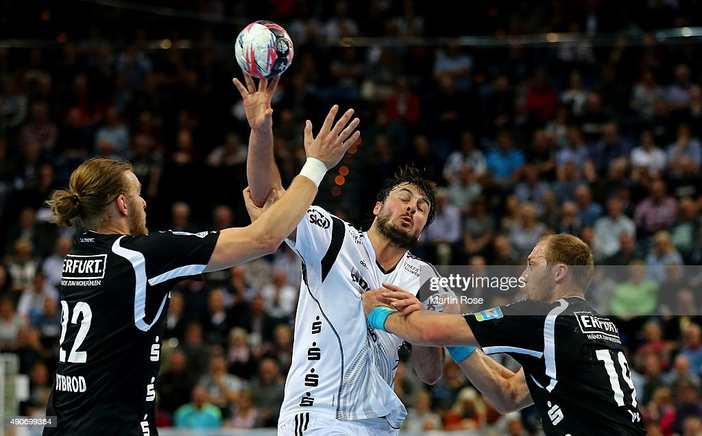 Domagoj Duvnjak (C) of Kiel challenges for the ball with Fabian Gutbrod #22 and Max Weiss #19 of Bergischer HC during the DKB HBL Bundesliga match between THW Kiel and Bergischer HC at Sparkassen Arena on September 30, 2015 in Kiel, Germany.