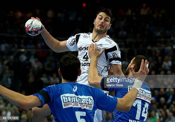 Domagoj Duvnjak of Kiel challenges for the ball with Ilija Brozovic and Drasko Nenadic of HSV Handball during the DKB HBL Bundesliga match between...